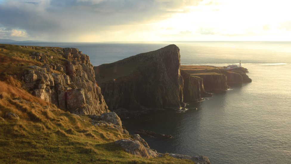 Neist Point lighthouse & the Little Minch with the outer Hebrides beyond